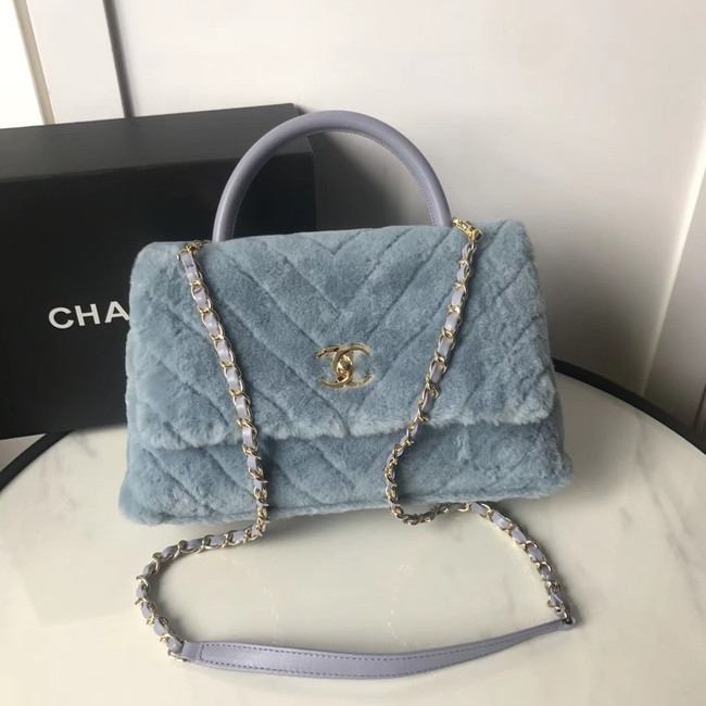 Chanel flap bag with top handle A92991 light blue