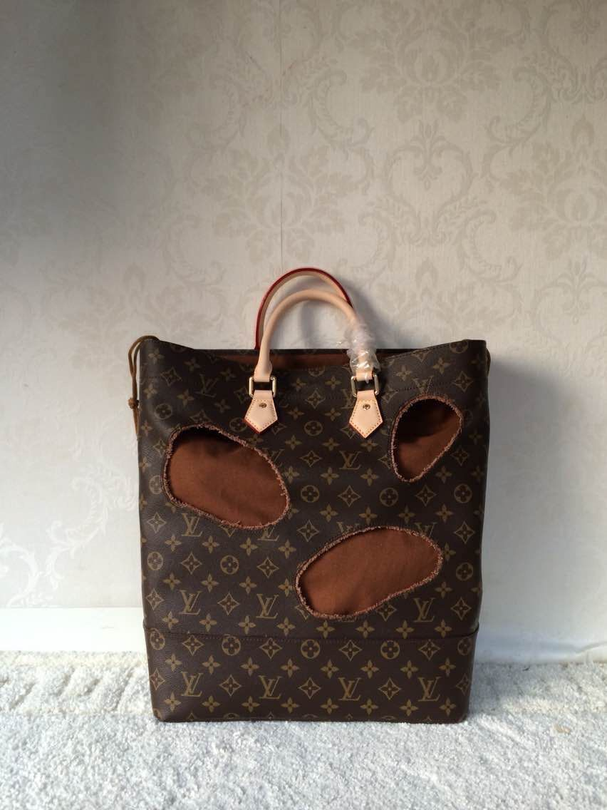 Louis Vuitton Original Leather Monogram canvas BAG WITH HOLES REI KAWAKUBO M40279